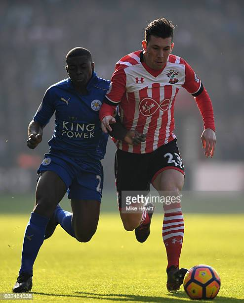 PierreEmile Hojbjerg of Southampton is challenged by Nampalys Mendy of Leicester during the Premier League match between Southampton and Leicester...