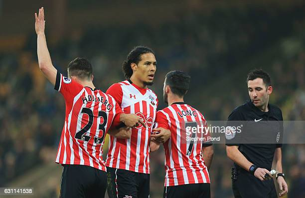 PierreEmile Hojbjerg Virgil van Dijk and Shane Long of Southampton make a wall during the Emirates FA Cup Third Round match between Norwich City and...