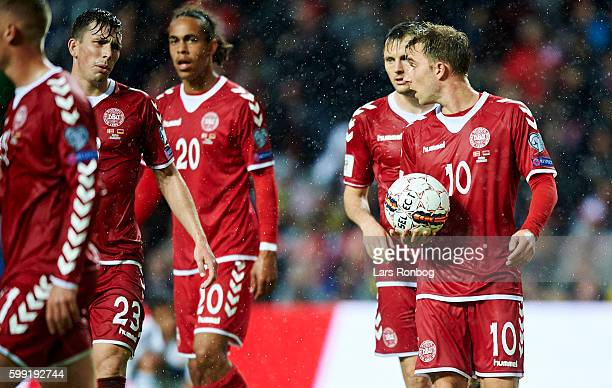 PierreEmile Hojbjerg William Kvist and Christian Eriksen of Denmark during the FIFA World Cup 2018 european qualifier match between Denmark and...