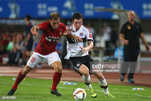 PierreEmilie Hojbjerg of Muenchen battles for the ball with Zhi Zheng of Guangzhou during the international friendly match between FC Guangzhou...