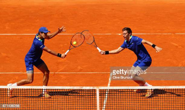 PierreHughes Herbert and Nicolas Mahut of France in action against Marc Lopez and Feliciano Lopez of Spain in their semi final doubles match on day...