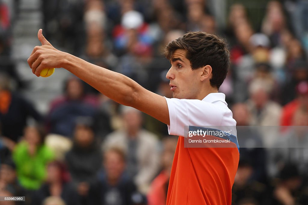 Pierre-Hughes Herbert of France gestures during the Men's Singles first round match against Alexander Zverev of Germany on day three of the 2016 French Open at Roland Garros on May 24, 2016 in Paris, France.