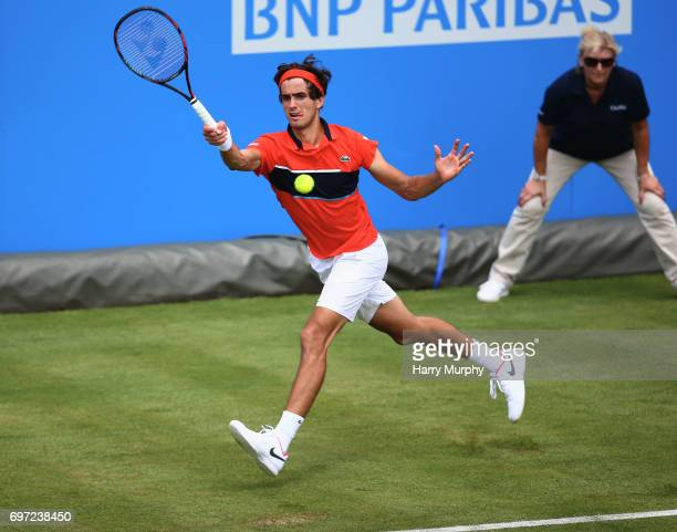 PierreHughes Herbert of France hits a forehand shot during his qualifying match against Stefan Kozlov of the United States ahead of the Aegon...