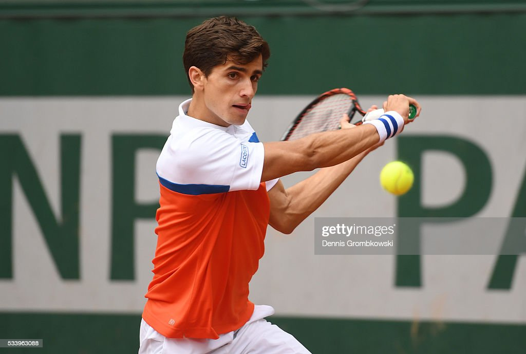 Pierre-Hughes Herbert of France plays a backhand during the Men's Singles first round match against Alexander Zverev of Germany on day three of the 2016 French Open at Roland Garros on May 24, 2016 in Paris, France.