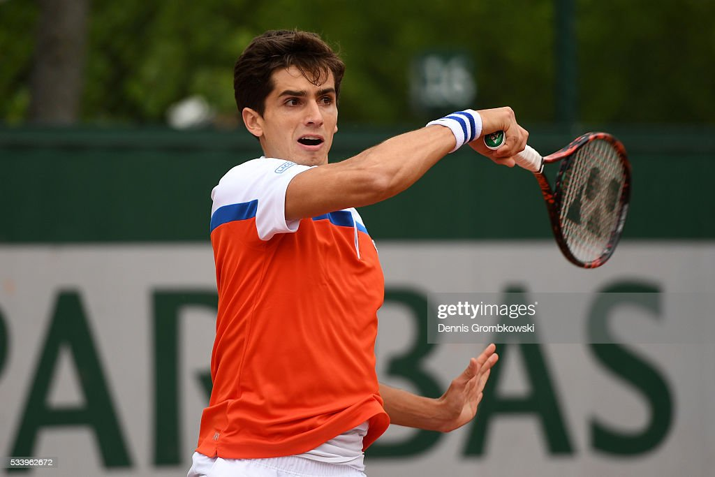 Pierre-Hughes Herbert of France plays a forehand during the Men's Singles first round match against Alexander Zverev of Germany on day three of the 2016 French Open at Roland Garros on May 24, 2016 in Paris, France.