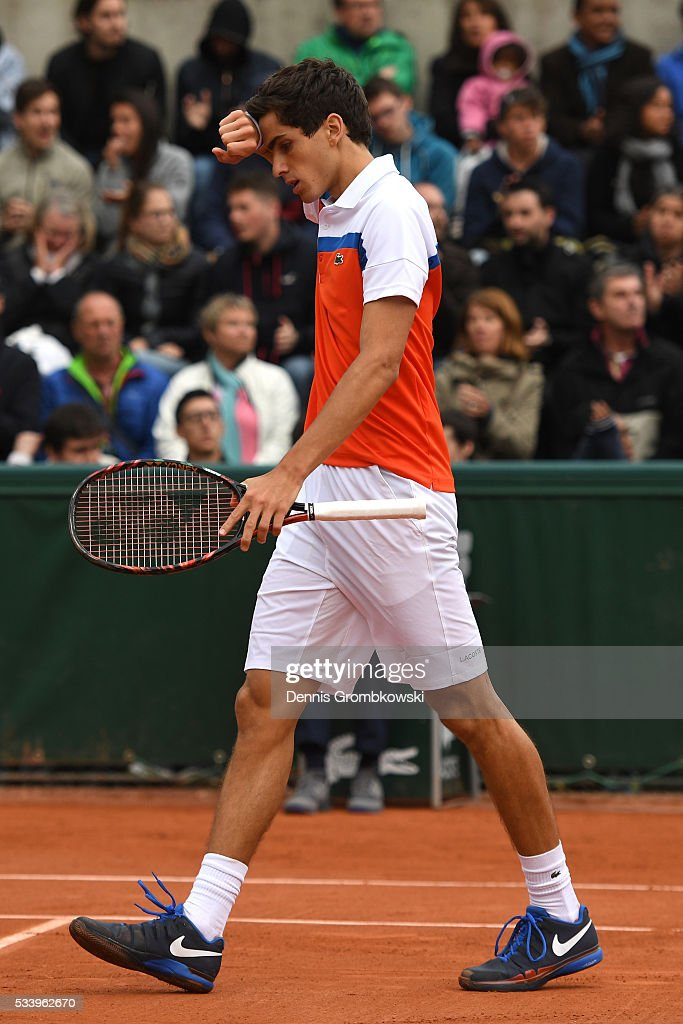 Pierre-Hughes Herbert of France reacts during the Men's Singles first round match against Alexander Zverev of Germany on day three of the 2016 French Open at Roland Garros on May 24, 2016 in Paris, France.