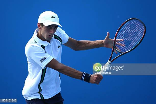 PierreHughes Herbert plays a backhand in his first round match against Pablo Andujar of Spain during day one of the 2016 Australian Open at Melbourne...