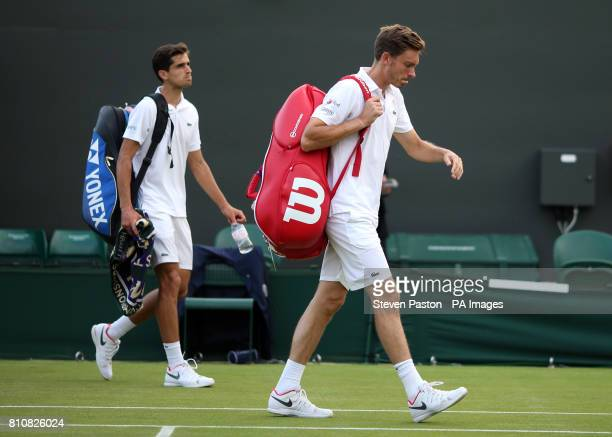 PierreHugues Herbert and Nicolas Mahut are dejected following defeat to Marcus Willis and Jay Clarke on day six of the Wimbledon Championships at The...