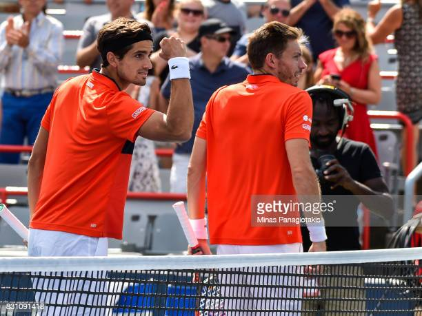 PierreHugues Herbert and Nicolas Mahut of France celebrate after defeating Rohan Bopanna of India and Ivan Dodig of Croatia 64 36 106 during the...
