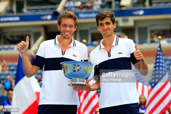 PierreHugues Herbert and Nicolas Mahut of France celebrate with the winner's trophy after defeating Jamie Murray of Great Britain and John Peers of...