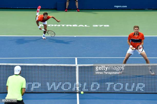 PierreHugues Herbert and Nicolas Mahut of France compete against Oliver Marach of Austria and Mate Pavic of Croatia during day nine of the Rogers Cup...