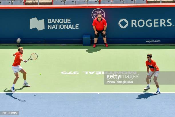 PierreHugues Herbert and Nicolas Mahut of France compete in a doubles match against Rohan Bopanna of India and Ivan Dodig of Croatia during day ten...