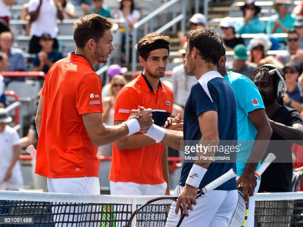 PierreHugues Herbert and Nicolas Mahut of France congratulate Rohan Bopanna of India and Ivan Dodig of Croatia on their match during day ten of the...