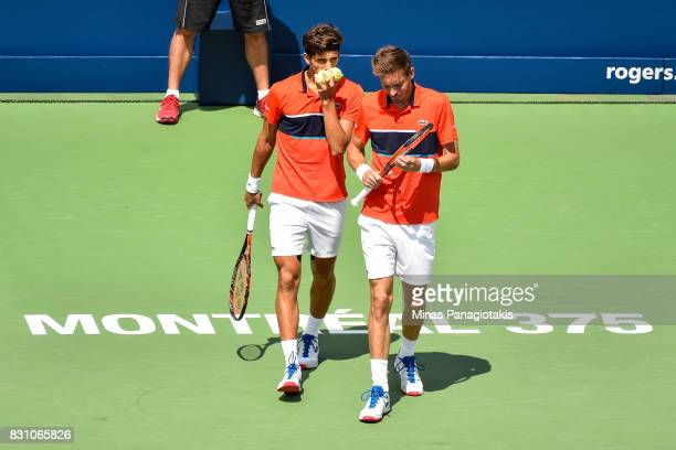 PierreHugues Herbert and Nicolas Mahut of France discuss their strategy in their doubles match against Rohan Bopanna of India and Ivan Dodig of...