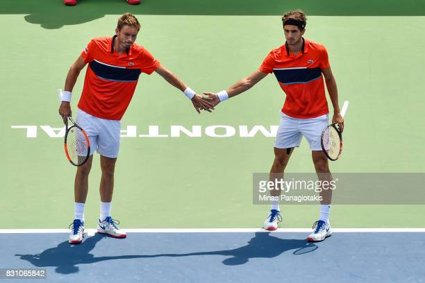 PierreHugues Herbert and Nicolas Mahut of France encourage one another in their doubles match against Rohan Bopanna of India and Ivan Dodig of...