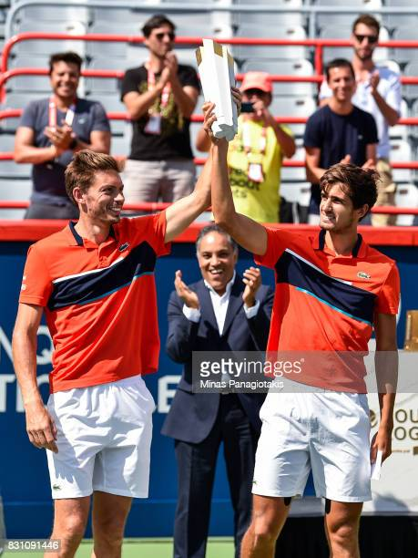 PierreHugues Herbert and Nicolas Mahut of France hoist the doubles trophy after defeating Rohan Bopanna of India and Ivan Dodig of Croatia 64 36 106...