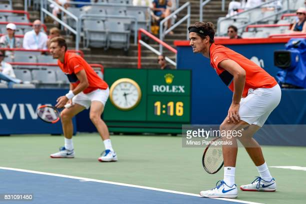 PierreHugues Herbert and Nicolas Mahut of France look on as they compete against Rohan Bopanna of India and Ivan Dodig of Croatia during day ten of...