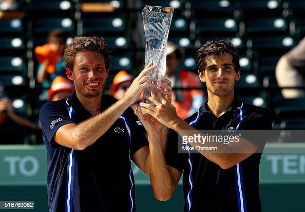 PierreHugues Herbert and Nicolas Mahut of France pose with the Butch Buchholz Trophy after winning the Doubles Final against Raven Klaasen of South...