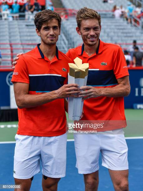 PierreHugues Herbert and Nicolas Mahut of France pose with the trophy after defeating Rohan Bopanna of India and Ivan Dodig of Croatia 64 36 106...