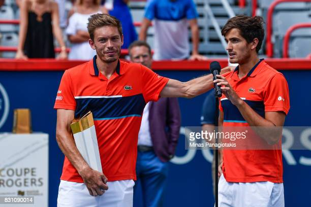 PierreHugues Herbert and Nicolas Mahut of France speak to the fans after defeating Rohan Bopanna of India and Ivan Dodig of Croatia 64 36 106 and...