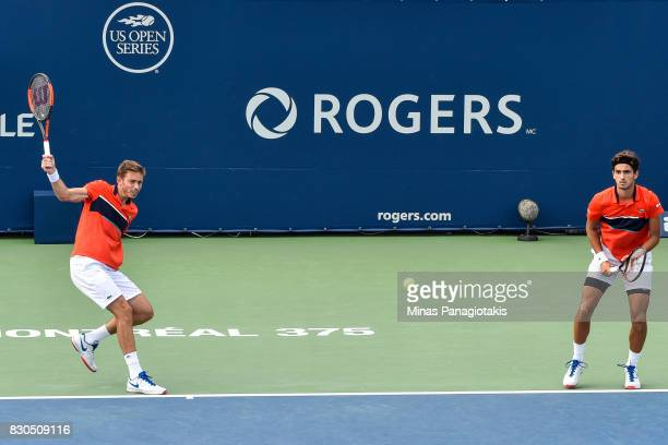 PierreHugues Herbert and teammate Nicolas Mahut of France compete in a doubles match against Mike and Bob Bryan of the United States during day eight...