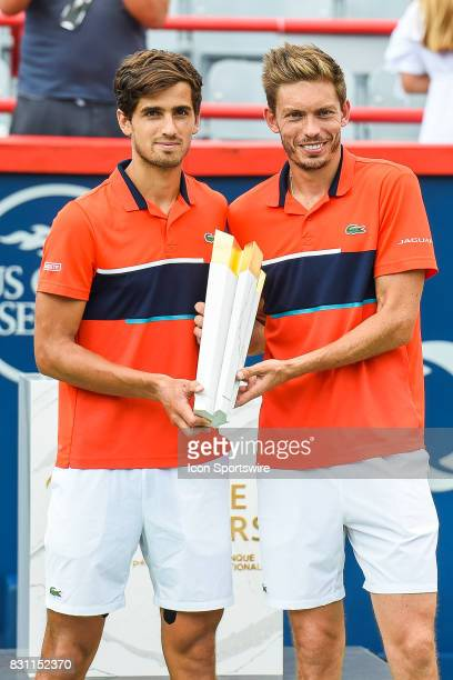 PierreHugues Herbert FRA0 and Nicolas Mahut with their trophy after their win in the double final round match at ATP Coupe Rogers on August 13 at...