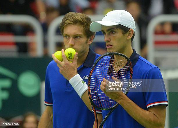 PierreHugues Herbert of France and his compatriot Nicolas Mahut react as they play against Radek Stepanek and Lukas Rosol of Czech Republic in a...
