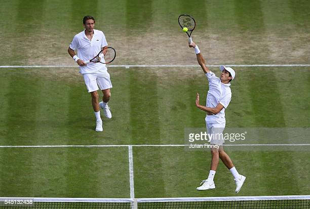PierreHugues Herbert of France and Nicolas Mahut of France return during the Men's Doubles third round match against Sam Groth of Australia and...