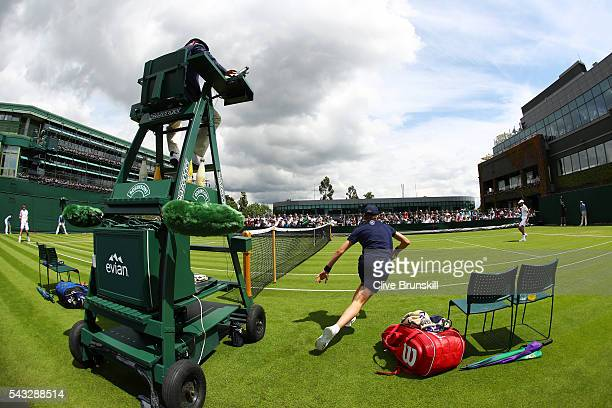 PierreHugues Herbert of France and Phillip Kohlschreiber of Germany in action during the Men's Singles first round match on day one of the Wimbledon...