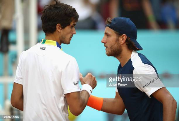PierreHugues Herbert of France is congratulated by Lucas Pouille of France after his three set win during day four of the Mutua Madrid Open tennis at...