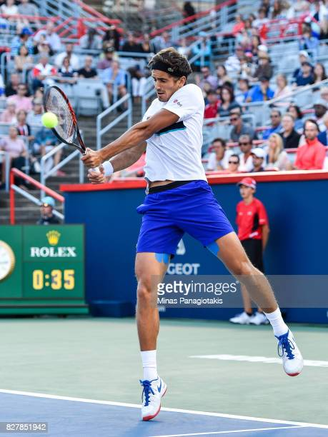 PierreHugues Herbert of France jumps as he hits a return against Jack Sock of the United States during day five of the Rogers Cup presented by...