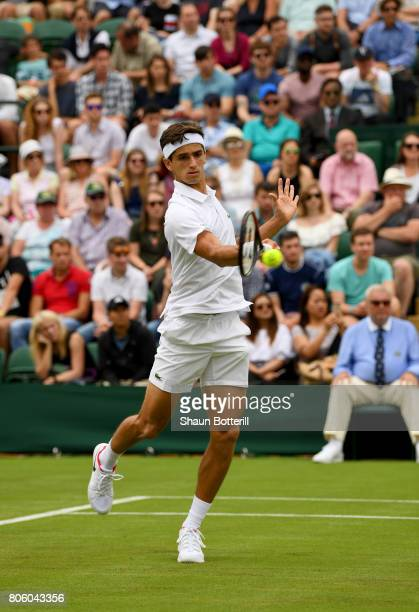 PierreHugues Herbert of France plays a forehand during the Gentlemen's Singles first round match against Nick Kyrgios of Australia on day one of the...