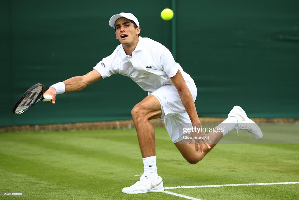 Pierre-Hugues Herbert of France plays a forehand shot during the Men's Singles first round match against Phillip Kohlschreiber of Germany on day one of the Wimbledon Lawn Tennis Championships at the All England Lawn Tennis and Croquet Club on June 27th, 2016 in London, England.