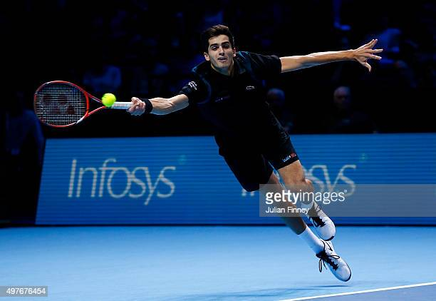 PierreHugues Herbert of France reaches for a forehand partnering Nicolas Mahut of France in their men's doubles match against Marcin Matkowski of...