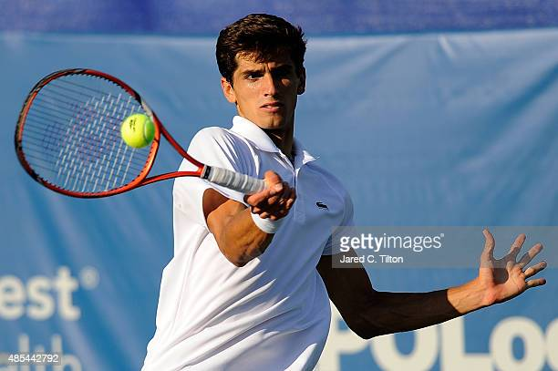 PierreHugues Herbert of France returns a shot from Pablo Carreno Busta of Spain during the fourth day of the WinstonSalem Open at Wake Forest...