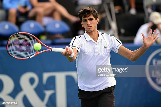 PierreHugues Herbert of France returns a shot from Steve Johnson during the fifth day of the WinstonSalem Open at Wake Forest University on August 28...