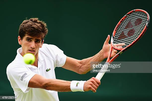 PierreHugues Herbert of France returns a shot in his Gentlemens Singles Second Round match against Bernard Tomic of Australia during day three of the...