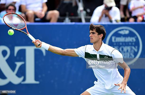 PierreHugues Herbert of France returns a shot to Kevin Anderson of South Africa during the men's final match of the WinstonSalem Open at Wake Forest...