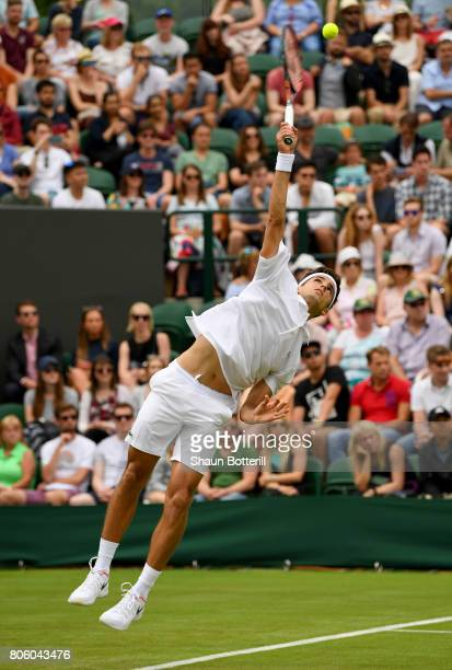 PierreHugues Herbert of France serves during the Gentlemen's Singles first round match against Nick Kyrgios of Australia on day one of the Wimbledon...