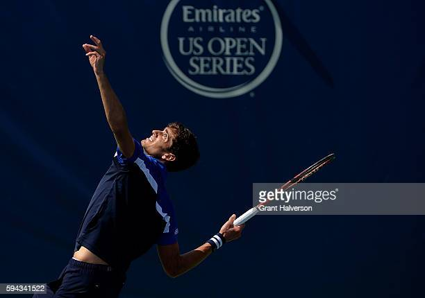 PierreHugues Herbert of France serves to Donald Young of the United States during the WinstonSalem Open at Wake Forest University on August 22 2016...