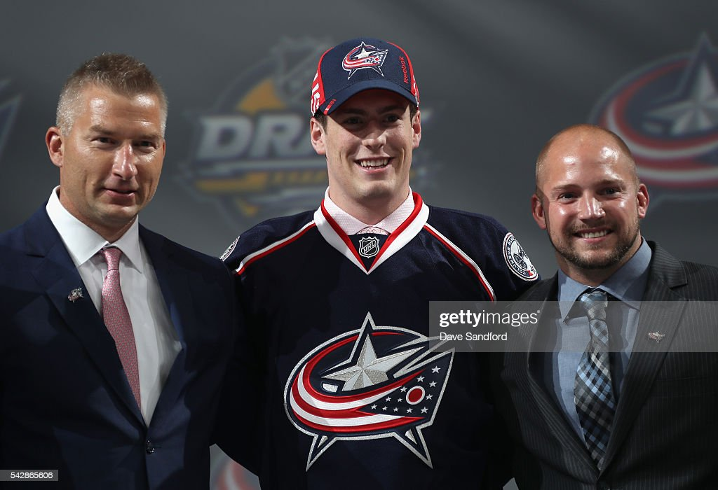 <a gi-track='captionPersonalityLinkClicked' href=/galleries/search?phrase=Pierre-Luc+Dubois&family=editorial&specificpeople=13636609 ng-click='$event.stopPropagation()'>Pierre-Luc Dubois</a> poses onstage for a photo with Columbus Blue Jackets personnel after being selected third overall by the Columbus Blue Jackets during round one of the 2016 NHL Draft at First Niagara Center on June 24, 2016 in Buffalo, New York.