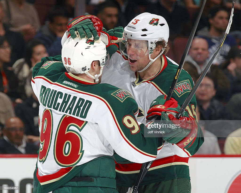 Pierre-Marc Bouchard #96 congratulates Jonas Brodin #25 of the Minnesota Wild who scored against the Vancouver Canucks during their NHL game at Rogers Arena March 18, 2013 in Vancouver, British Columbia, Canada.