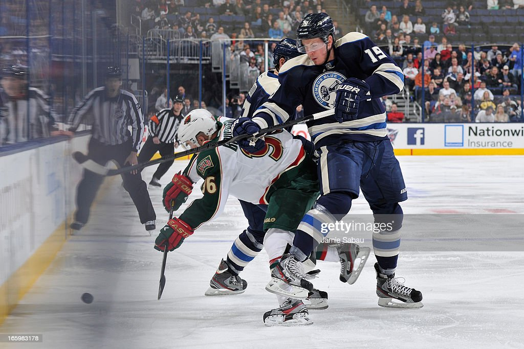 Pierre-Marc Bouchard #96 of the Minnesota Wild and Ryan Johansen #19 of the Columbus Blue Jackets battle for a loose puck during the first period on April 7, 2013 at Nationwide Arena in Columbus, Ohio.