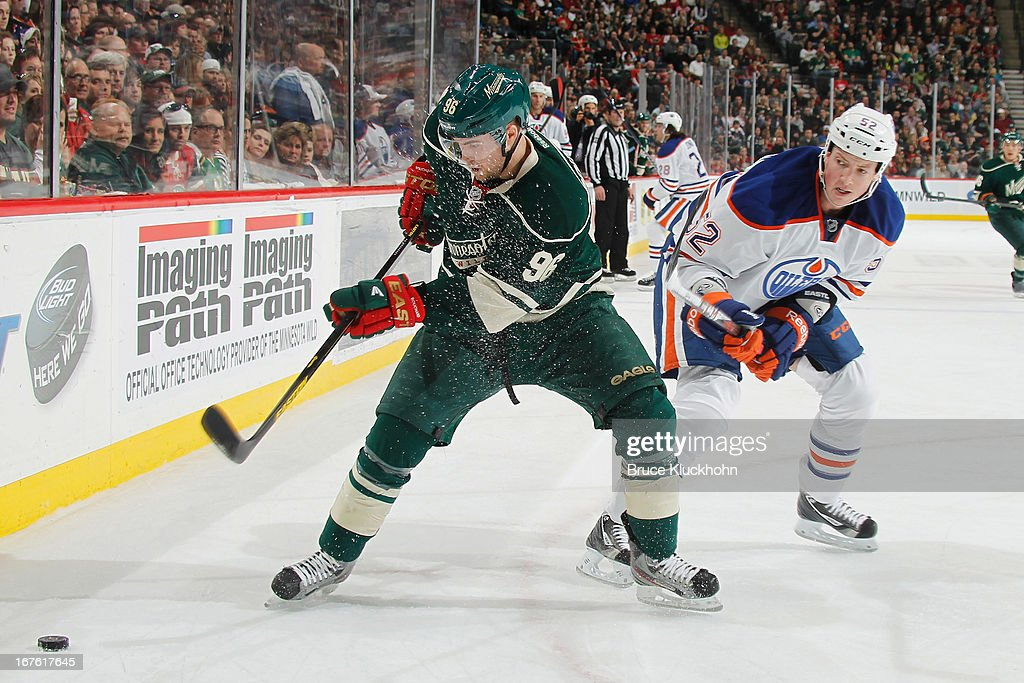 Pierre-Marc Bouchard #96 of the Minnesota Wild handles the puck with <a gi-track='captionPersonalityLinkClicked' href=/galleries/search?phrase=Jerred+Smithson&family=editorial&specificpeople=224622 ng-click='$event.stopPropagation()'>Jerred Smithson</a> #52 of the Edmonton Oilers defending during the game on April 26, 2013 at the Xcel Energy Center in St. Paul, Minnesota.