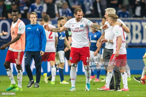 PierreMichel Lasogga celebrate with Lewis Holtby and other team mates after the Bundesliga match between FC Schalke 04 and Hamburger SV at...