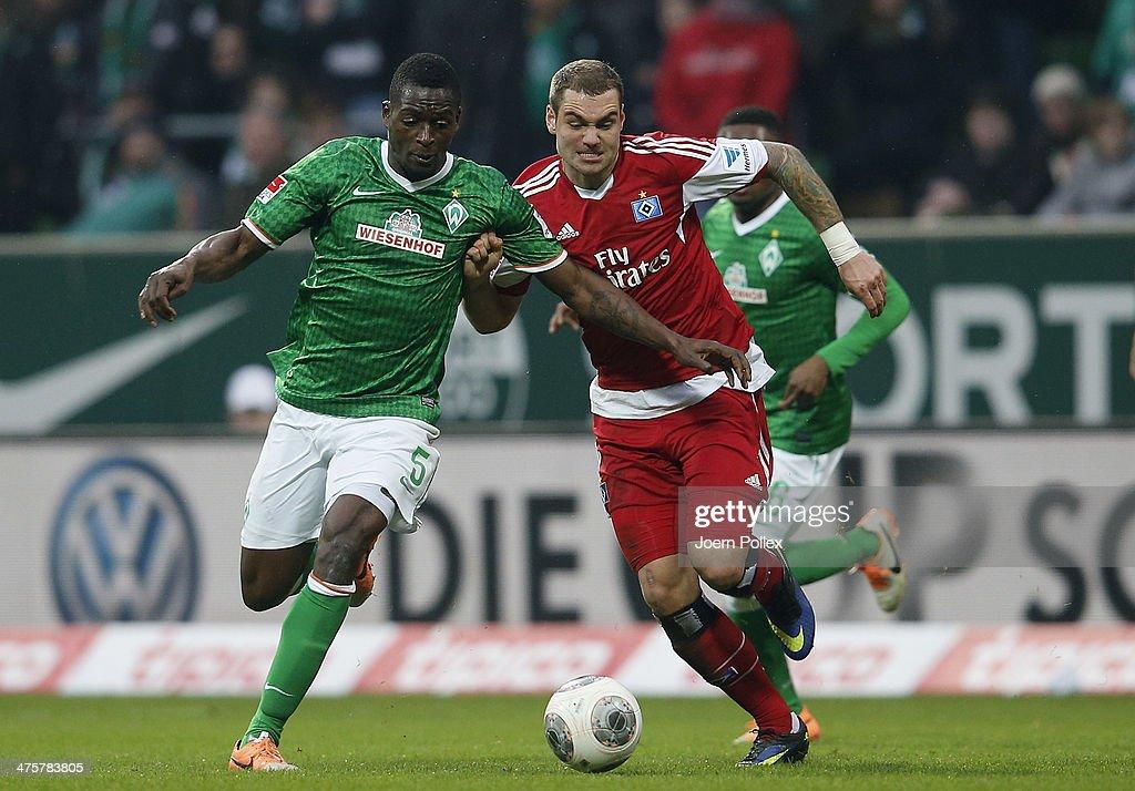 PierreMichel Lasogga of Hamburg and Assani Lukimya of Bremen compete for the ball during the Bundesliga match between Werder Bremen and Hamburger SV...