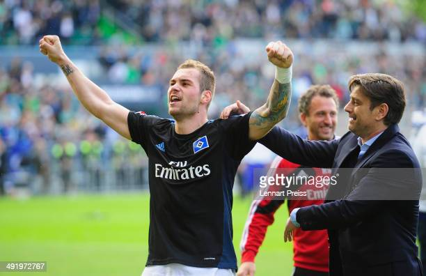 PierreMichel Lasogga of Hamburg and Oliver Kreuzer manager of Hamburg celebrate after the Bundesliga Playoff Second Leg match between SpVgg Greuther...