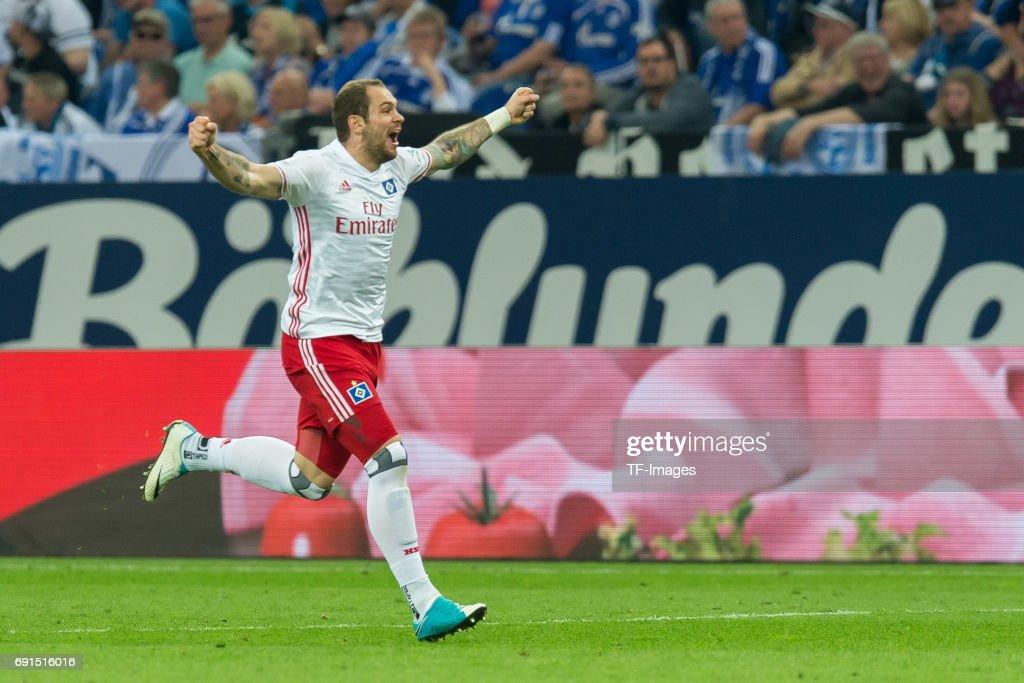 Pierre-Michel Lasogga of Hamburg celebrates after scoring his team`s first goal during to the Bundesliga match between FC Schalke 04 and Hamburger SV at Veltins-Arena on May 13, 2017 in Gelsenkirchen, Germany.
