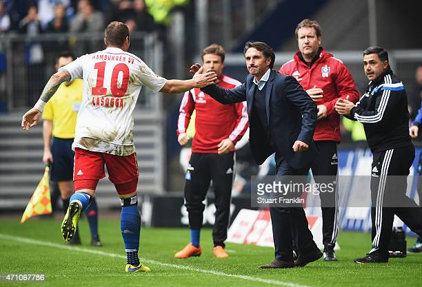 PierreMichel Lasogga of Hamburg celebrates scoring his goal with Bruno Labbadia head coach of Hamburg during the Bundeslga match between Hamburger SV...