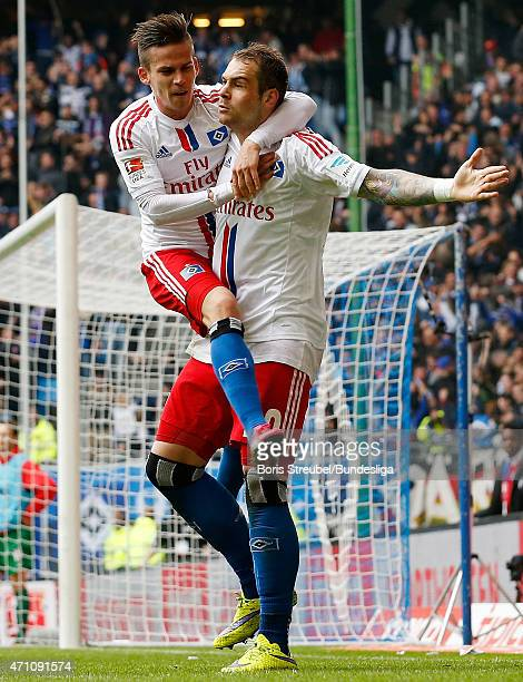 PierreMichel Lasogga of Hamburg celebrates scoring his second goal during the Bundeslga match between Hamburger SV and FC Augsburg at Imtech Arena on...